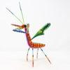 Mantis V tallada en madera de copal por Paulino Blas
